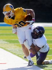 Augie's Charlie Hayes is pushed out of bounds by Minnesota State's Nathan Hancock in Saturday's game at Kirkeby-Over Stadium, Oct 25, 2014.