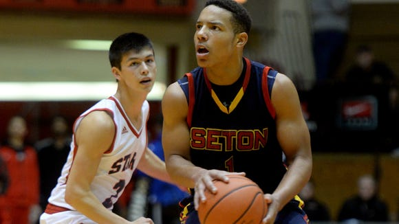 Seton Catholic?s Desmond Bane eyes the rim against Bedford North Lawrence during the 9th Annual Bob Wettig Memorial Tournament on Wednesday. The Stars beat the Cardinals, 68-61. Seton Catholic's Desmond Bane moves the ball against Bedford North Lawrence during a basketball game in the 9th Annual Bob Wettig Memorial Tournament Wednesday, Dec. 30, 2015 in the Tiernan Center.