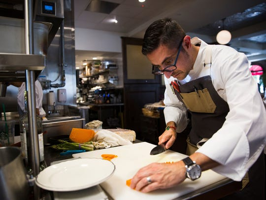 Chef Vincenzo Betulia prepares a cheese plate during lunch May 9, 2017, at The French Brasserie Rustique on Fifth Avenue South in Naples.