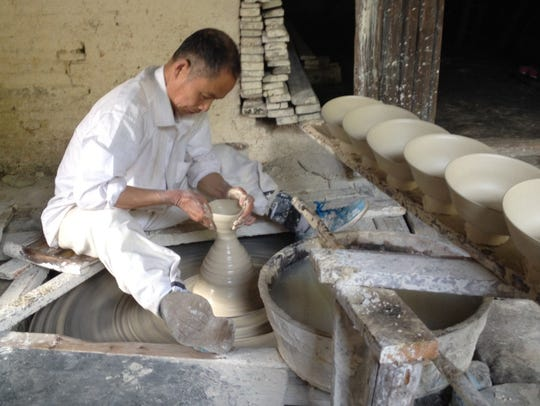 A famous potter, Mr. Wang, demonstrates how potter