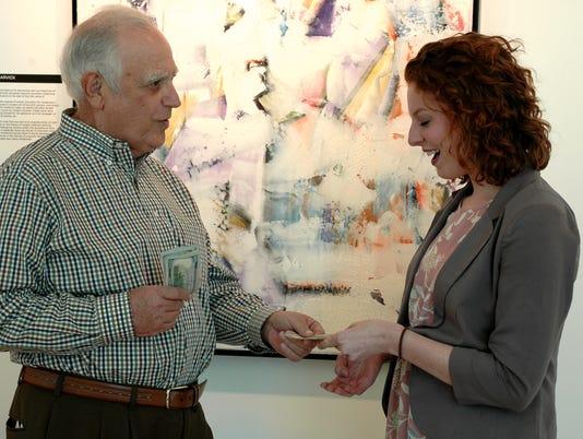 636541274262763919-Jeff-Kahn-Chair-of-CPVA-Advisory-Board-awards-prize-money-to-Nikki-Lewis.jpg