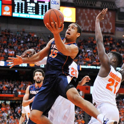 Virginia guard Malcolm Brogdon attempts a shot near the basket during the first half on Monday against Syracuse.