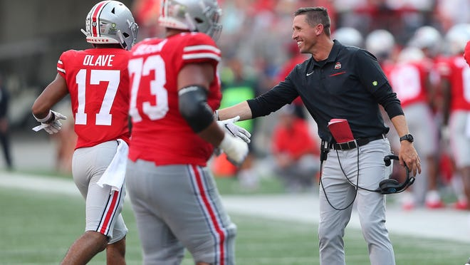 Brian Hartline, Ohio State's receivers coach and a former Dolphin, celebrates with players during a game against Miami (Ohio).