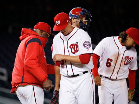 Washington Nationals relief pitcher Sammy Solis, center, leaves the field after being relieved during the ninth inning of the team's baseball game against the Miami Marlins in Washington, Thursday, April 6, 2017. Marlins won 4-3. (AP Photo/Manuel Balce Ceneta)