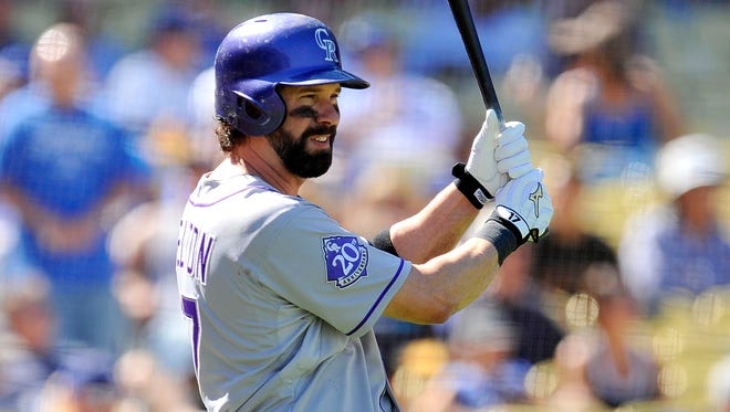 Colorado Rockies first baseman Todd Helton on deck before coming up to hit in the second inning against the Los Angeles Dodgers at Dodger Stadium.