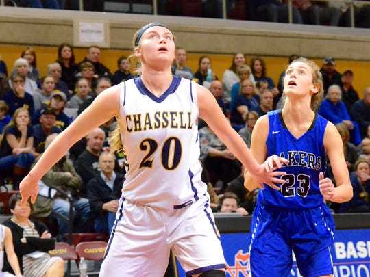 Chassell senior Sydney Danison (left) boxes out Waterford