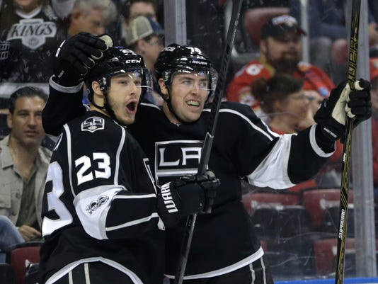 Los Angeles Kings' Dustin Brown (23) celebrates with Tanner Pearson, right, after scoring a goal during the first period of an NHL hockey game against the Florida Panthers, Thursday, Feb. 9, 2017, in Sunrise, Fla. (AP Photo/Lynne Sladky)