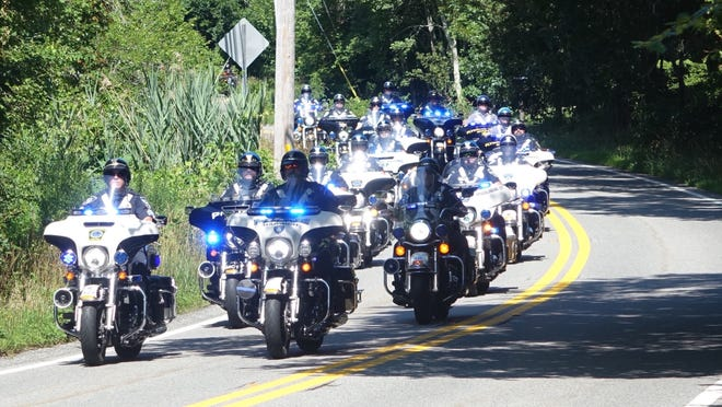 A police escort made up of patrols from all over the Cape and Plymouth leads the riders as they set out from the Barnstable County Sheriff's Office in Bourne. The ride headed head down-Cape along Route 6A through West Barnstable and on to Yarmouth.