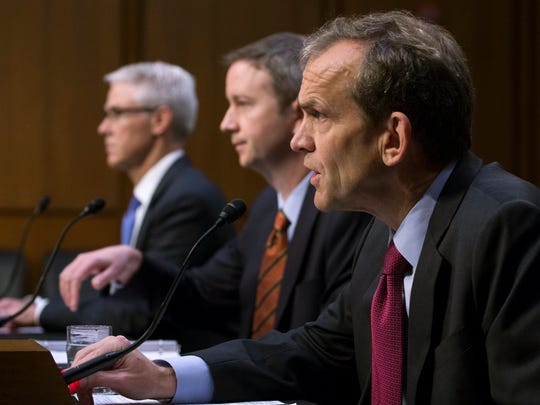 Kent Walker (R) senior vice president and general counsel for Google Inc, with Colin Stretch (L), general counsel for Facebook and Sean Edgett (C), acting general counsel for Twitter, testifies before the Senate Select Intelligence Committee, Nov. 1, 2017.