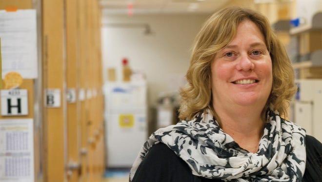 Lisa K. Denzin, PhD, assistant professor of pediatrics at Rutgers Robert Wood Johnson Medical School, in her lab at the medical school's Child Health Institute of New Jersey.