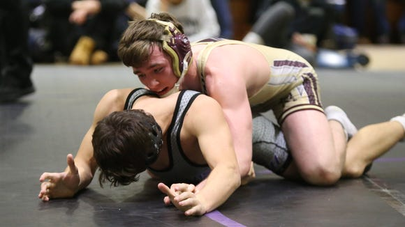 Ioma Prep's Colin Realbuto wrestles Monroe-Woodbury's Joe McGinty in a 138-pound match of the Shoreline Classic wrestling tournament at New Rochelle High School in New Rochelle on Saturday, January 6, 2018.