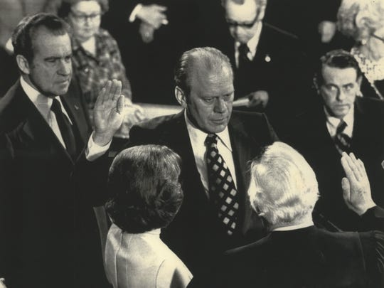 Gerald R. Ford (center) is sworn in as the 40th vice president of the United States in ceremonies in the House Chamber Dec. 6, 1973. President Richard Nixon is at left.