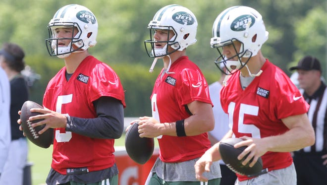 Quarterbacks, Christian Hackenberg, Bryce Petty and Josh McCown get ready to participate in passing drills during minicamp in June.