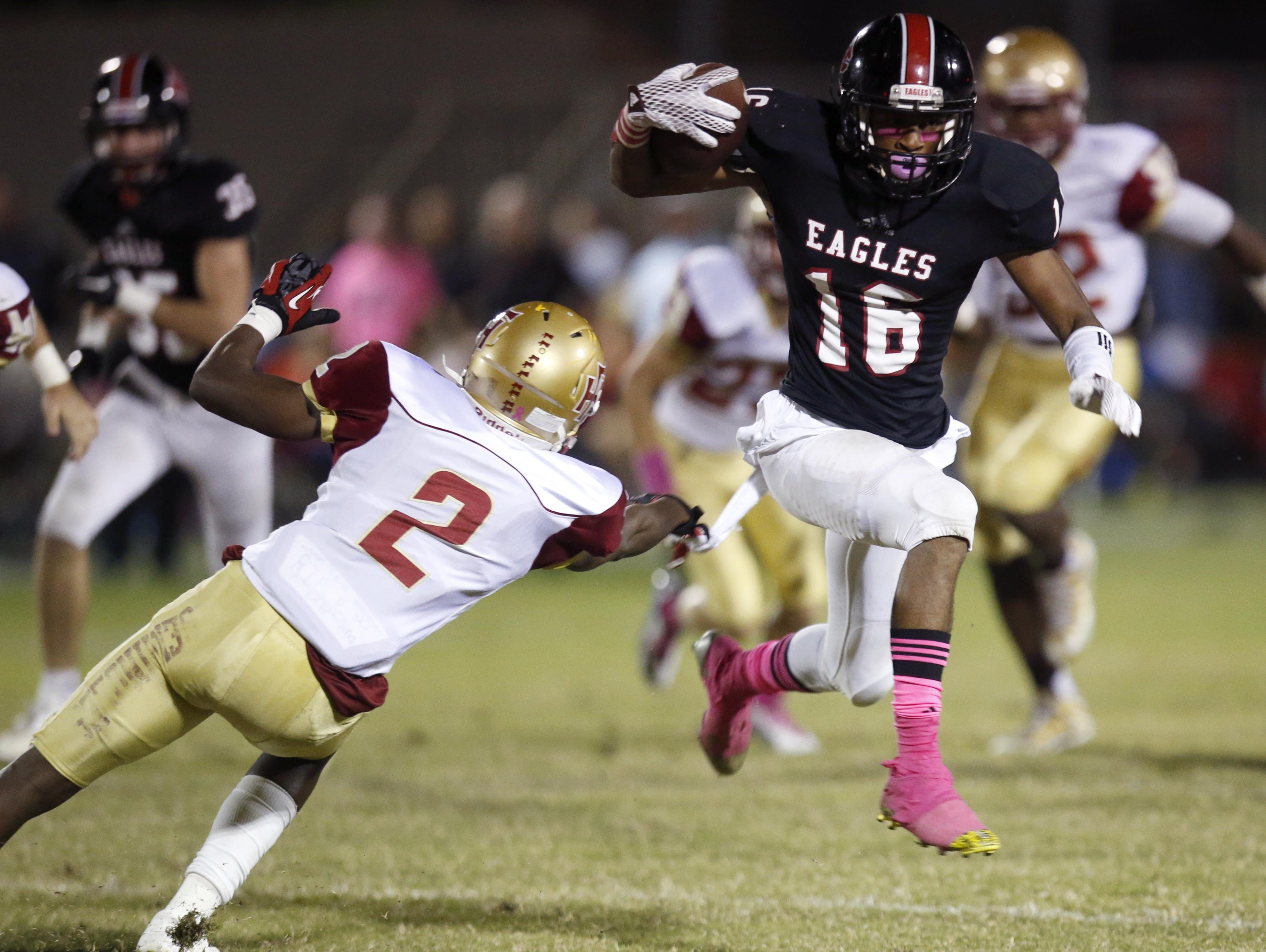 NFC's Korey Charles jukes Florida High's Quinterrius Hill at NFC on Friday. Charles rushed 17 times for 159 yards and a 30-yard touchdown, while adding a 39-yard touchdown on a screen pass.