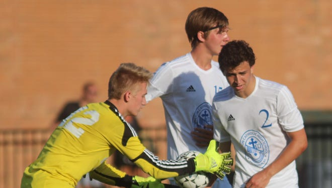 Covington Catholix goalkeeper Sam Romes, left, congratulates Austin Flynn earlier in the season.