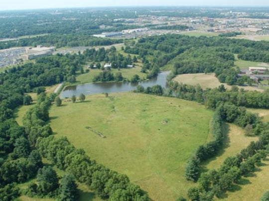 Eagle Realty Group, a division of Western & Southern, has amassed 270 acres of land in Boone County near the Cincinnati/Northern Kentucky International Airport for a potential office building development.