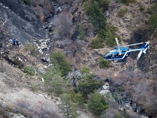 Rescue workers sift through debris on the mountain