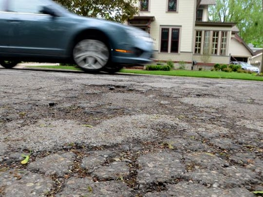 The City of Northville will be going to the voters in August to ask them to approve a millage to improve local roads, like this section of crumbling, pot-holed High Street.