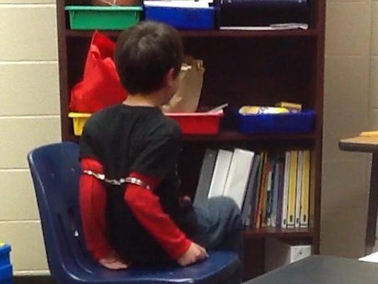 635746355207179931-handcuffs