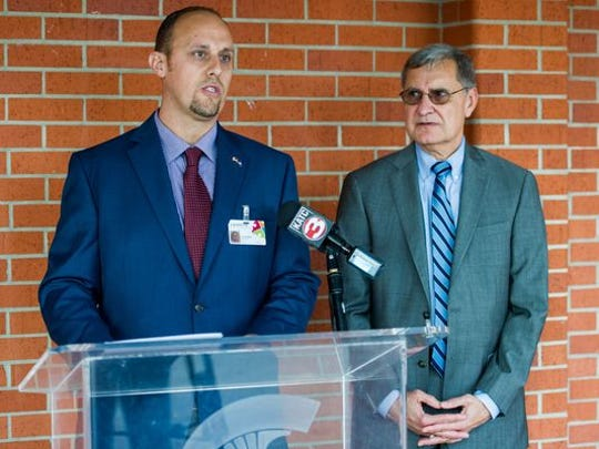Lafayette Parish School Board member Jeremy Hidalgo, left, has urged calmness and unity in deciding the name of a new high school. Also pictured is Lafayette Parish Superintendent Donald Aguillard.