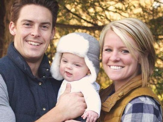 Davey and Amanda Blackburn pose with their child, Weston. Amanda was fatally shot in her Indianapolis home Nov. 10, 2015. Two men have been arrested in the slaying.