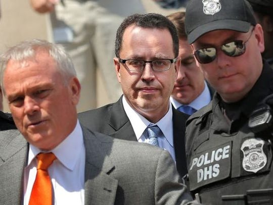 Jared Fogle, former pitchman for Subway, is escorted