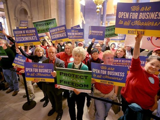 Supporters and opponents of the Religious Freedom Restoration Act, or RFRA, made their opinions known outside the Indiana House chambers at the Statehouse on March 19, 2015.