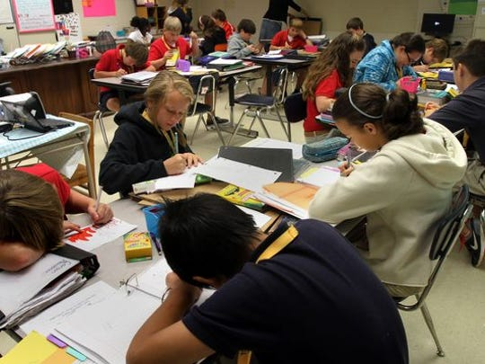 Students work in a seventh grade social studies class at Youngsville Middle School in 2012.