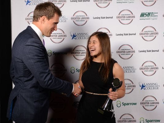 Freyja Garbaccio, Girls Swimmer of the Year, from Okemos High School reacts to meeting former Spartan and current Washington Redskins Kirk Cousins backstage during the LSJ Sports Awards at the Lansing Center on Tuesday, June 7, 2016.