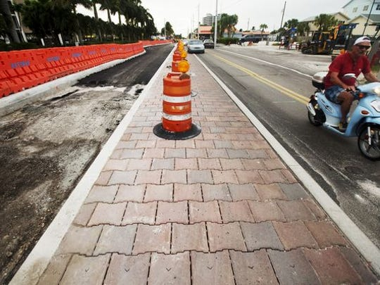 A stretch of Estero Boulevard at Fort Myers Beach showing the decorative pavers  damaged by heavy traffic. A new section will have steel plates placed over the median while traffic is diverted over them  during construction work.