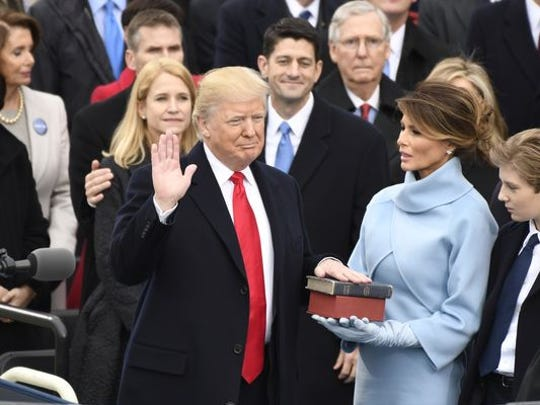 Donald Trump takes the oath of office as the 45th president
