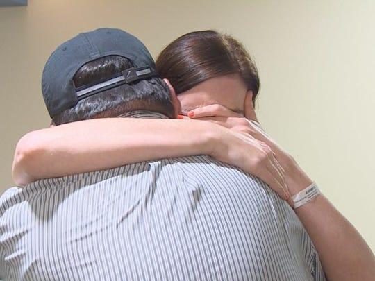 Emily Ocheltree hugs Jaime Martinez, a man who helped