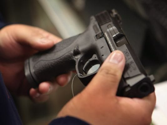 636298598582103810-Pistol-photo.jpg