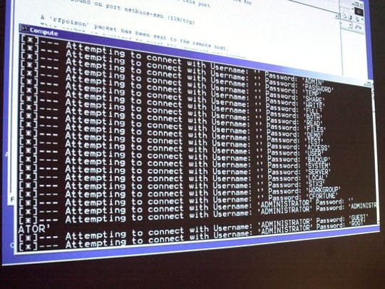 In this Jan. 10, 2002, file photo, a computer screen shows a password attack in progress at the Norwich University computer security training program in Northfield, Vt.