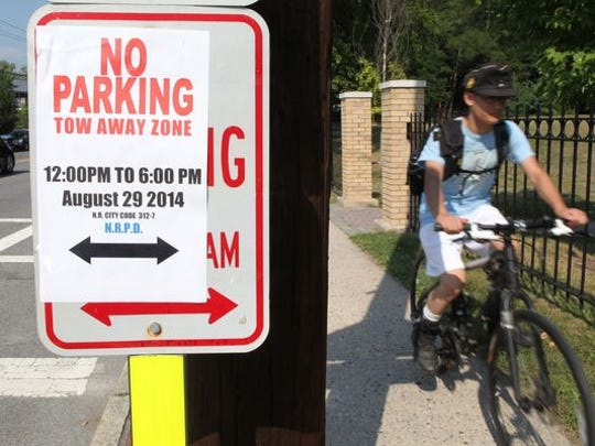 """No parking"" signs are visible along Route 1/ Main Street in New Rochelle Aug. 27, 2014. They were placed in preparation of President Obama's upcoming visit to the area."