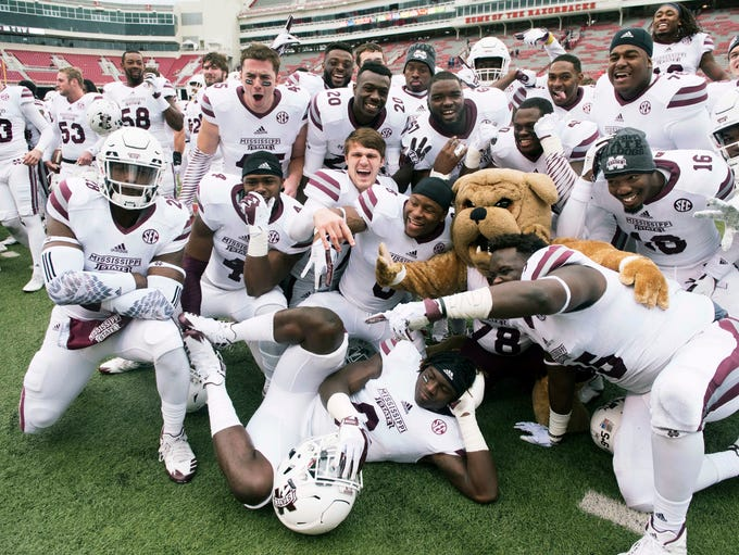 Mississippi State players celebrate after their 28-21