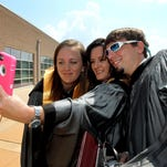 Taking a selfie after their graduation from Hinds Community College on July 30 with technical certificates as paramedics were, from left, Lindsey Kupihe of Madison, Natalie Jones of Canton and Drew Hartzog of Terry.