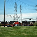 Traffic backs up along Allen Road in Woodhaven in 2013 as a train slows down going into the Canadian National yard in Flat Rock. The city has been trying for decades to get enough funding to build a railroad overpass to alleviate daily traffic jams.