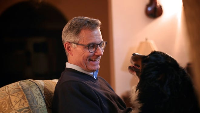 Federal judge Terrence G. Berg and family dog, Rusty, photographed at his home on Thursday, November 19, 2015, in Detroit.