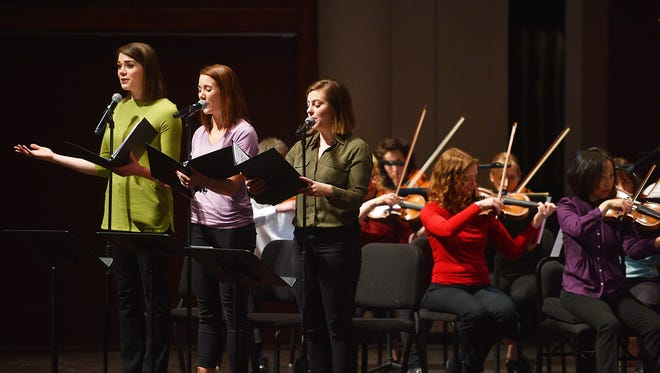 Miss South Dakota Miranda Mack, left, sings along with college students from SDSU and Augustana University during the South Dakota Symphony Orchestra program with Sioux Falls School District fourth-graders Monday, April 9, at the Washington Pavilion.