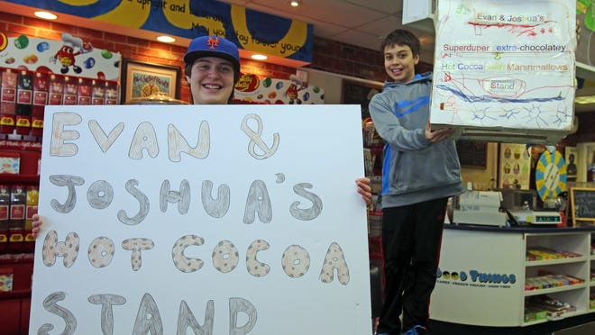 Mamaroneck brothers Evan, left, and Josh Greenberg are hosting their charity hot cocoa stand for the eighth year, with proceeds going to the Pediatric Cancer Foundation. The brothers were photographed at All Good Things in Scarsdale on Tuesday.