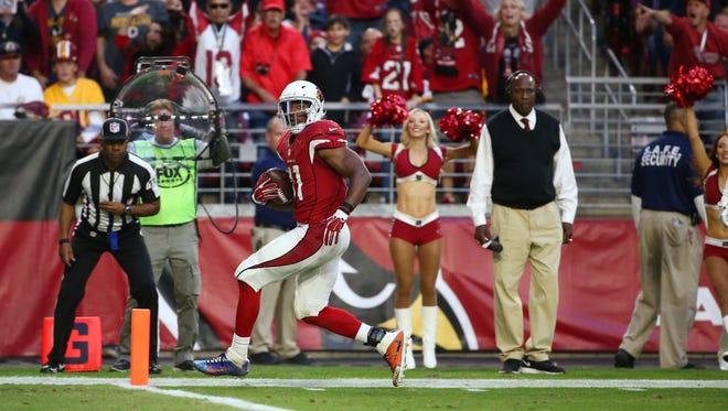Arizona Cardinals' David Johnson scores a touchdown against the Washington Redskins in the second half on Dec. 4, 2016 in Glendale, AZ.