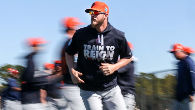 Tigers pitcher Mark Lowe runs drills during spring training at Joker Marchant Stadium on Feb. 28.