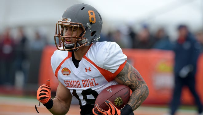 Jan 27, 2016: North squad wide receiver D.J. Foster of Arizona State (18) carries the ball during Senior Bowl practice at Ladd-Peebles Stadium.