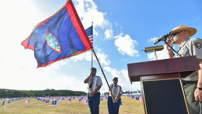 Members of the Southern High School Color Guard present the U.S. and Guam Flag during the ceremony dedicated to Memorial Day at the War in the Pacific National Historical Park in Asan on May 28, 2017.