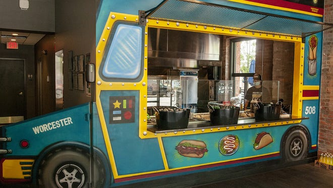The inside of Franklin Street Fare, a take-out eatery at 72 Franklin St., Worcester, is painted to look like a food truck.