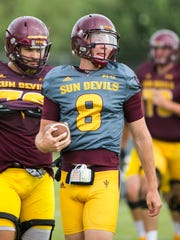 ASU's Blake Barnett (8) warms up with the team at ASU's