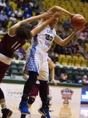 North Central's  Diamond Nevills, left, fights for a rebound against Merryville's Jania Williams in the Allstate Sugar Bowl/LHSAA GirlsÕ Top 28 Basketball Tournament in Hammond March 3, 2016.