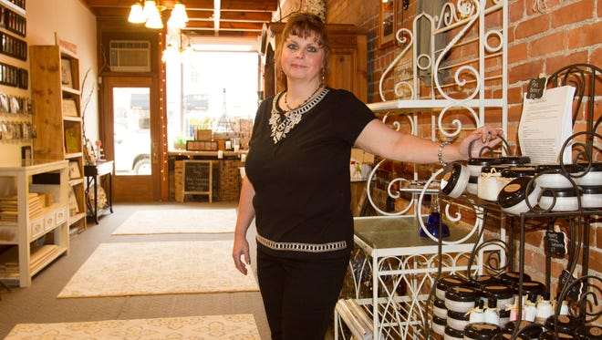 Zen Artisan Boutique co-owner Kim Goddard, an herbalist, formulates the pain-relief creams that are one of a variety of offerings at the soon-to-open downtown Howell store.