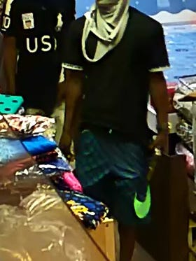 Metro police are searching for these two men who robbed Dubai Exotic store Saturday.